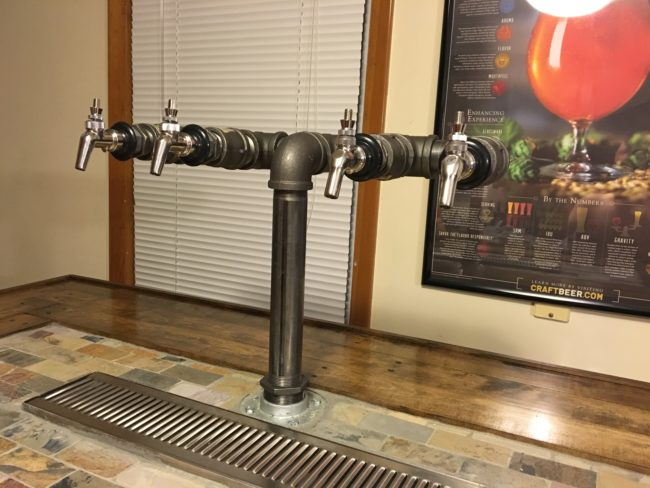 He assembled his tap after that, which was designed to dispense four different types of beer.