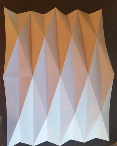 You can't create an origami lamp without folding some paper!