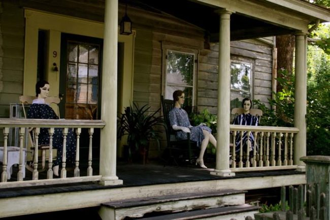 This is what the porch looks like on an ordinary day. Those people lounging in the rocking chairs? They're mannequins, fully dressed in early 20th-century clothing with freaky, painted-on faces.
