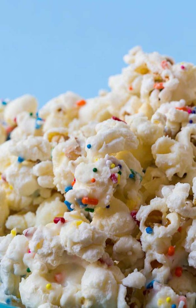 """<a href=""""http://spicysouthernkitchen.com/cake-batter-popcorn/"""" target=""""_blank"""">Cake batter-covered popcorn</a> is the ultimate movie snack."""