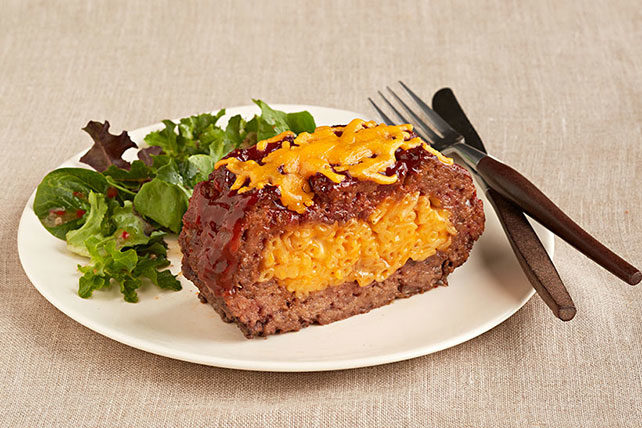 "What's better than meatloaf? Stuffing <a href=""http://www.kraftrecipes.com/recipes/macaroni-cheese-stuffed-meatloaf-182807.aspx?cm_mmc=Social-_-Pinterest-_-CPC-_-MacaroniCheeseStuffedMeatloaf&pp=0"" target=""_blank"">mac and cheese</a> inside for an even heartier dinner."