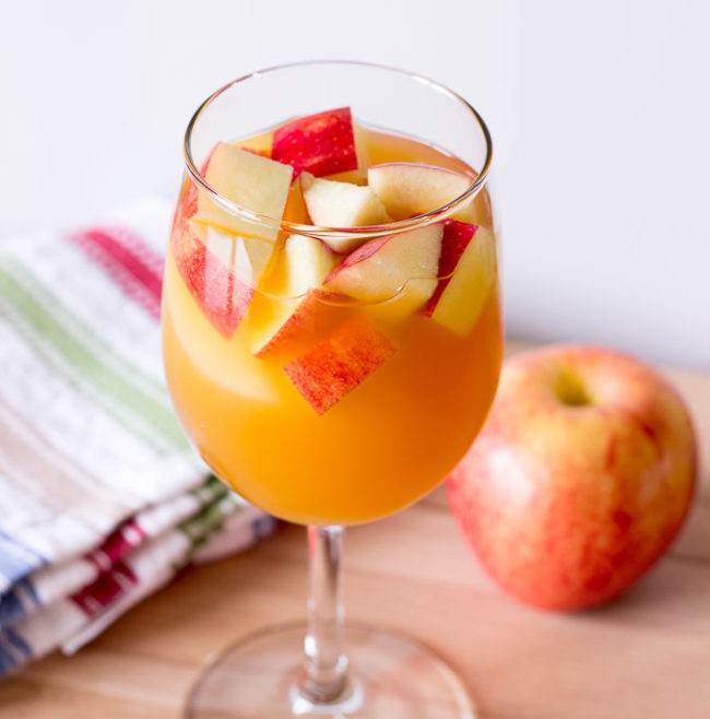 "Smoothly transition from summer sangria to this <a href=""http://www.thewholesomedish.com/caramel-apple-sangria/"" target=""_blank"">caramel apple version</a>."
