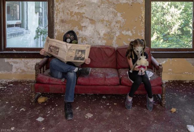 """Still too unsafe to venture outside, our post-apocalyptic father and daughter are stuck inside. The only entertainment they have is each other and whatever items were left over. Dad discovered a heap of old newspapers. The edition he reads today ironically reads 'Fresh Air Is Free,' while the young girl becomes closer with her stuffed toy doll."""