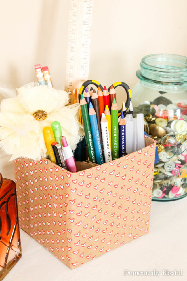 """Don't throw out another empty tissue box. Instead, make a <a href=""""http://domesticallyblissful.com/diy-craft-supply-holder/"""" target=""""_blank"""">custom desk organizer</a>."""