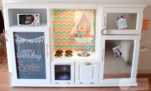 """Give your kids the little kitchen they've always wanted by reusing an old <a href=""""http://www.southernrevivals.com/2014/02/vintage-entertainment-center-turned.html"""" target=""""_blank"""">entertainment center</a>."""