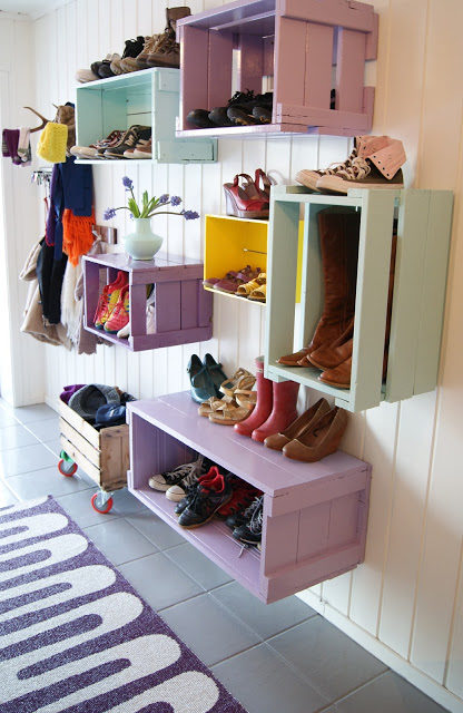 """Reuse empty wooden crates as a colorful <a href=""""http://theverden.blogspot.com/2010/12/rom-for-rom-barnehageinngangen.html"""" target=""""_blank"""">shelving alternative</a>."""
