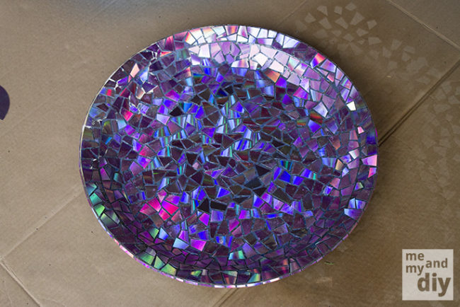 """With music sales going digital, you can now give your birdbath a facelift with this epic <a href=""""http://www.meandmydiy.com/2013/05/mosaic-tile-birdbath-using-recycled-dvds.html"""" target=""""_blank"""">CD mosaic</a>."""