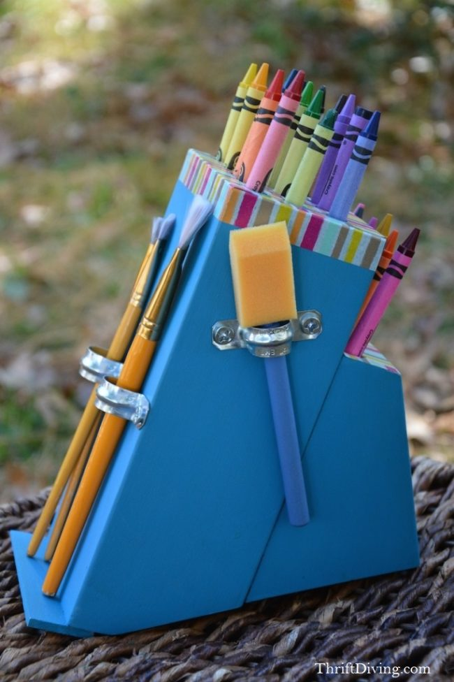 """Turn a knife block into a <a href=""""http://thriftdiving.com/diy-crayon-holder-from-a-knife-block/"""" target=""""_blank"""">kid-friendly crayon holder</a>."""