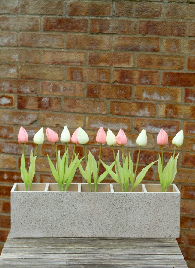 """Use that CD rack and make an epic <a href=""""http://claireabellemakes.com/2015/03/30/diy-upcycled-garden-planter/"""" target=""""_blank"""">garden planter</a>."""