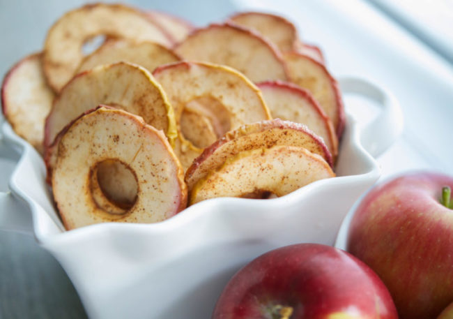 "These <a target=""_blank"" href=""http://www.carriesexperimentalkitchen.com/cinnamon-apple-chips/#_a5y_p=3836336"">cinnamon apple chips</a> will keep your snacking healthy(ish)."