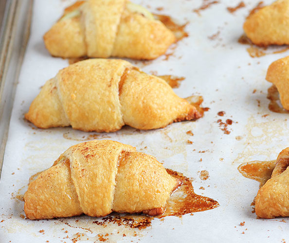 """<a target=""""_blank"""" href=""""http://theblondcook.com/2014/11/apple-pie-bites/#_a5y_p=3046884"""">Croissants</a> only get better when you bake apples inside them."""