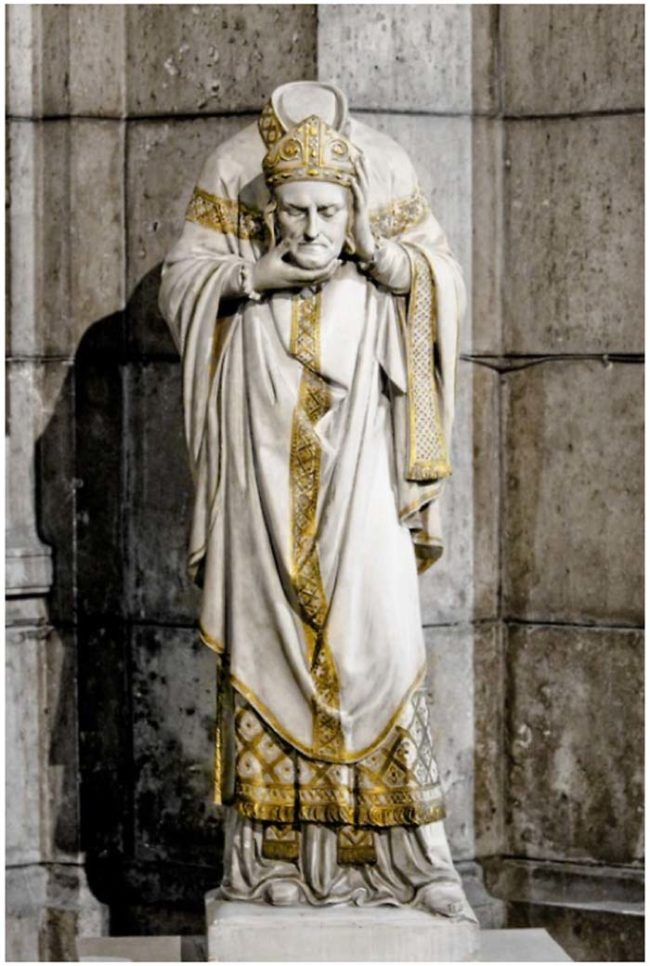 This is a statue of St. Denis. Can you guess how he died?