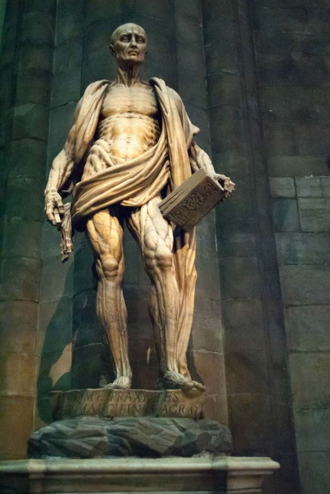 Here we have a statue of Bartholomew the Apostle. He was apparently flayed alive by the Romans. That cape he's wearing? It's not a cape at all. It's his skin.