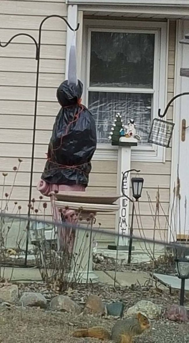 This person's attempt at keeping their religious statue from freezing is a bit frightening.
