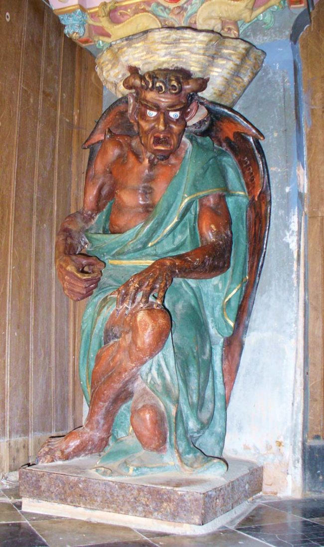 No, this isn't from a Satanic church. It's just a sculpture of the Devil hanging out in a Christian church.