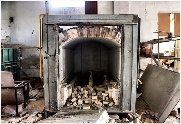 This furnace was used to bake the porcelain. It looks like a few doll parts never made it out.