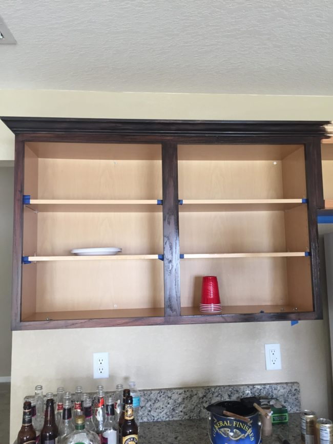 The couple began by removing the doors and drawers to give them a light sanding before applying the stain.