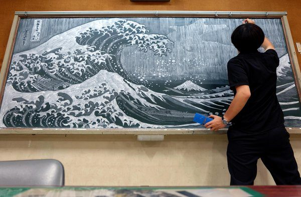"His chalkboard creations first caught the attention of the public after he depicted characters from Japanese anime series ""Your Name."""