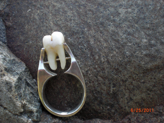 "Propose to your partner in style with this delightfully freaky <a href=""https://www.etsy.com/listing/76836242/real-human-tooth-tension-set-and-riveted?ga_order=most_relevant&amp;ga_search_type=all&amp;ga_view_type=gallery&amp;ga_search_query=real%20human%20teeth&amp;ref=sr_gallery_11"" target=""_blank"">human tooth ring</a>."
