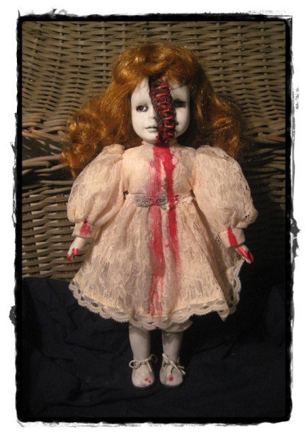 "Isn't this <a href=""https://www.etsy.com/listing/295186199/split-face-vampire-red-head-creepy?ga_order=most_relevant&amp;ga_search_type=all&amp;ga_view_type=gallery&amp;ga_search_query=bloody%20doll%20head&amp;ref=sr_gallery_14"" target=""_blank"">doll</a> just the cutest thing you've ever seen?"