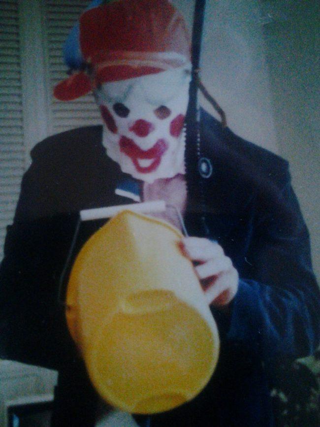 Is that clown carrying a gun?