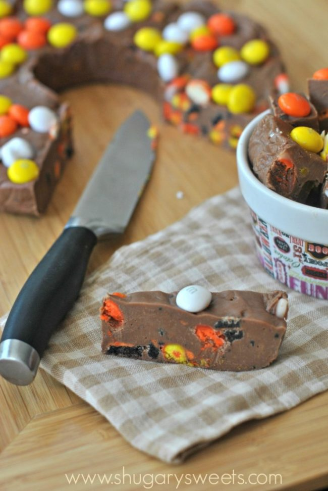 "Top your favorite <a href=""http://www.shugarysweets.com/2013/10/halloween-fudge-ring"" target=""_blank"">fudge recipe</a> with some Halloween candies to bring the treat to the next level."