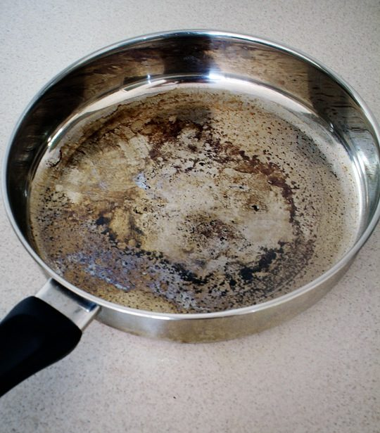 "Clean burned-on crud from your pots and pans with <a href=""http://www.apartmenttherapy.com/how-to-clean-burnt-pots-scorched-pans-140547"" target=""_blank"">this vinegar cocktail</a>."