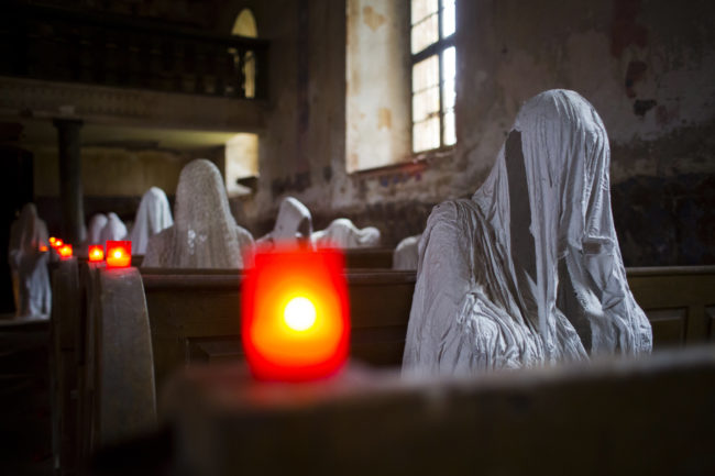 Hadrava made the ghosts by dipping fabric in plaster, then allowing it to dry in the shape of a hooded human figure.