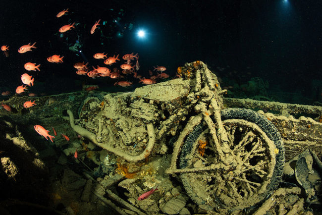 Among the wrecks are many recognizable items, such as this motorcycle.