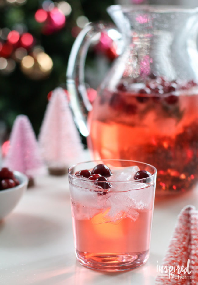 "This <a href=""http://inspiredbycharm.com/2015/12/jingle-juice-holiday-punch.html"" target=""_blank"">jingle juice</a> is chock-full of whipped cream vodka, champagne, and cranberries."