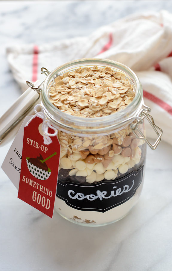 """Give them their favorite <a href=""""http://www.wellplated.com/cookie-mix-in-a-jar/"""" target=""""_blank"""">cookie recipe in a jar</a>."""