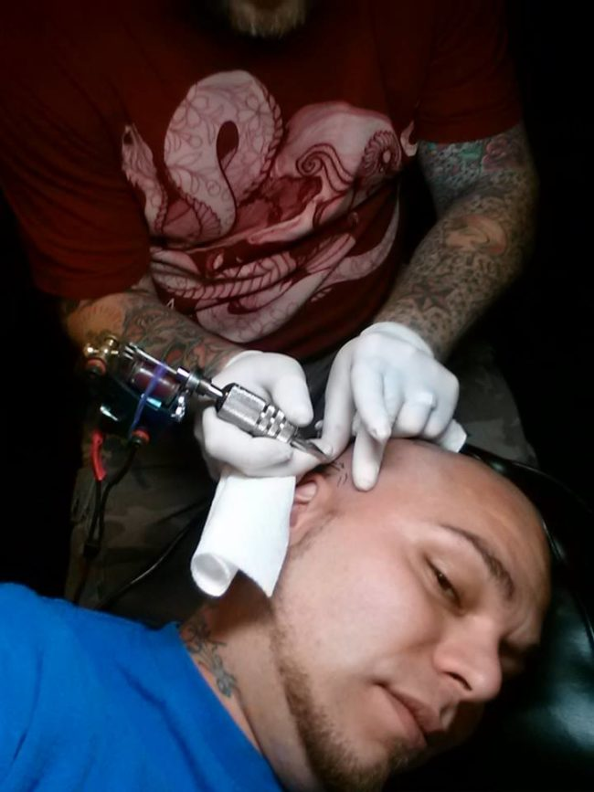 Josh found a tattoo artist and asked him to tattoo the shape of the scar on his head, too.